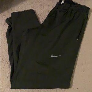Army green Nike pants